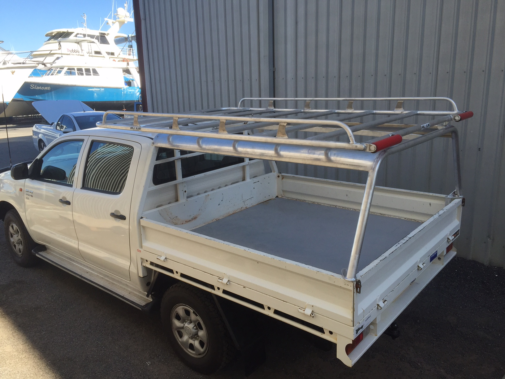 Tradesman rack with rollers over canopy frame & Tradesman rack with rollers over canopy frame | Great Racks